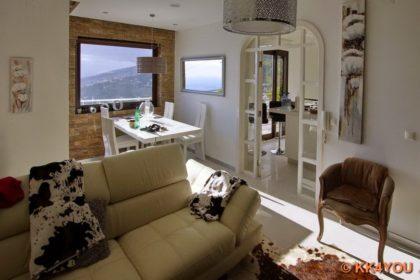 Wohnzimmer und Essecke Maison Blanche