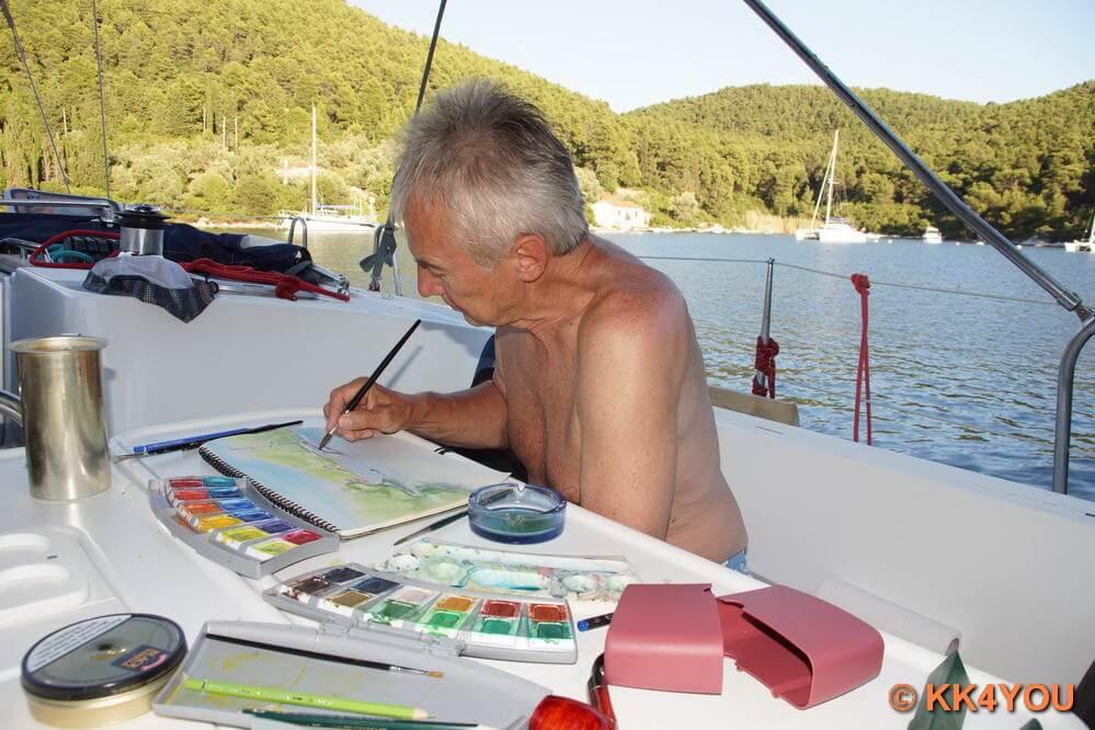 Küstler animiert durch die Schönheit der Bucht  Panormos